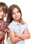 Cool little kids posing over white background